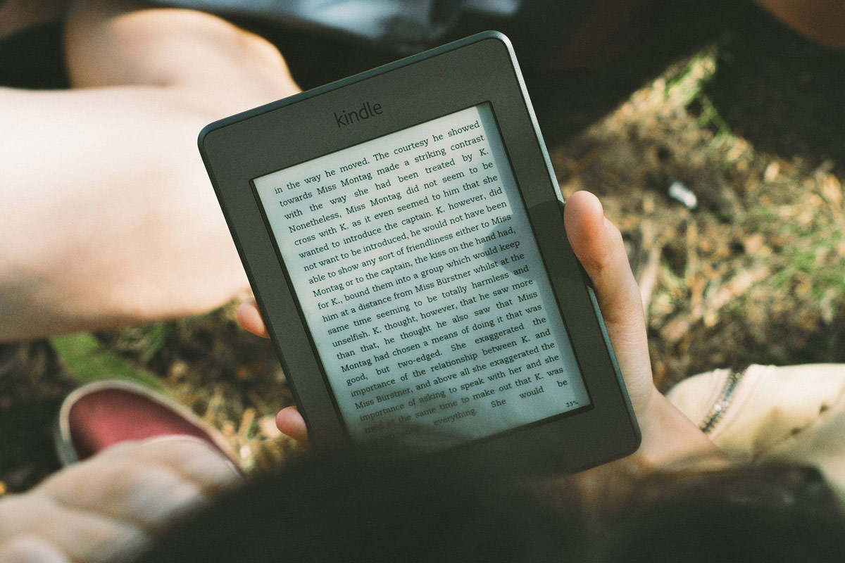 Reader reading on Kindle